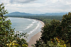 Karambunai beach shoreline seen from the peak of a hill. Royalty Free Stock Image