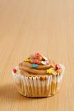 Karamel cupcake Stock Afbeelding