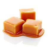 Karamellsüßigkeiten und Karamellsoße Stockbild