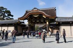 Karamon Gate Of Nijo Castle in Kyoto, Japan. Visitors walk past the Karamon Gate of Nijo Castle in Kyoto, Japan. Nijo Castle was built in 1603 as the Kyoto Stock Image