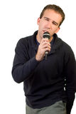 Karaoke. A caucasian man singing karaoke, isolated on a white background Royalty Free Stock Photography