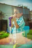 Karaoke boy Stock Images