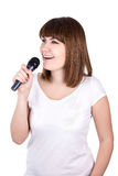 Karaoke concept - portrait of young beautiful woman singing with Royalty Free Stock Photography