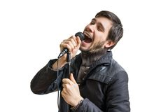 Karaoke concept. Young man holds microphone and singing song. Stock Photography