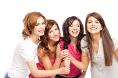 Karaoke fun. Group of young women having fun at karaoke Stock Photography