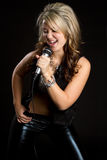 Karaoke Girl. Beautiful karaoke girl holding microphone Stock Photography