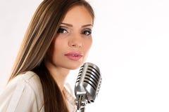 Karaoke Girl Singing isolated on white background Stock Photos