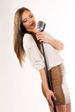 Karaoke Girl Singing isolated on white background Royalty Free Stock Photos