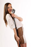 Karaoke Girl Singing isolated on white background Royalty Free Stock Photo