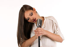 Karaoke Girl Singing isolated on white background Stock Photo