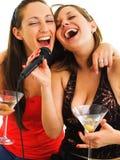 Karaoke. Girls singing on white background, with martini glasses Stock Photography