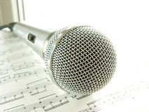 Karaoke microphone. Silver karaoke microphone with notes stock image