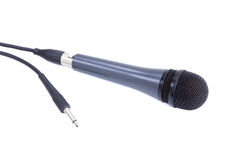 Karaoke microphone with cord isolated on white Royalty Free Stock Photo