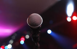 Karaoke microphone in a disco. Concert microphone with disco lights stock photo