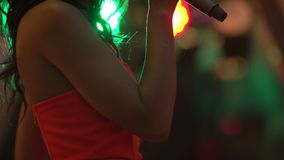 Karaoke party. Beauty girls with a microphone singing and dancing stock video