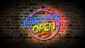 KARAOKE sign on a brick wall background