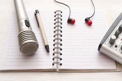 Karaoke singer. Microphone. Sound recording studio background. Song lyrics copy space. Audio recording studio desk table. Karaoke mock up. Song lyrics stock photography