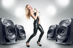 Karaoke singer at night club. Karaoke singer at night in black leather clothing Stock Photography