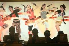 Karaoke singing. Group of friends having fun karaoke singing at familiy karaoke in indonesia Stock Image