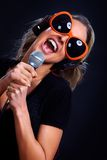 Karaoke singing woman. Happy singing woman with headphones  and microphone. Karaoke Stock Photography