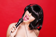 Karaoke woman listening to music on headphones Royalty Free Stock Images