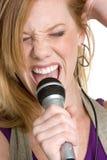 karaokemikrofonsångare Fotografering för Bildbyråer
