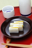 Karasumi daikon, bottarga萝卜,日本米酒的开胃菜 免版税库存照片