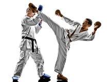 Karate μαχητές σπουδαστών εφήβων ατόμων που παλεύουν την προστασία Στοκ Εικόνες