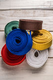 Karate belts. Many karate belts of different colors stock images