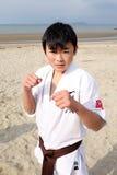 Karate boy. EHIME, JAPAN - January 3: Japanese karate boy sports training at the season of winter at the Ichinomiya Beach, January 3, 2012 in Ehime, Japan stock photos