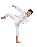 Karate boy exercising Stock Images