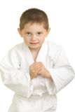 Karate boy in greeting bow. Little karate boy in greeting bow against white background Stock Photos