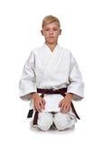 Karate boy meditation Stock Photography