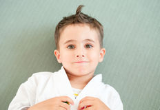 Karate boy relaxing in sport hall Royalty Free Stock Photo