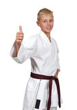 Karate boy showing thumb up Stock Photo