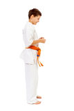 Karate boy smiling isolated on white Stock Photography