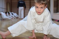 Karate boy in sport hall royalty free stock image