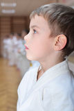Karate boy in sport hall Stock Images