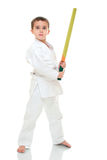Karate boy with toy sword in white Royalty Free Stock Photography