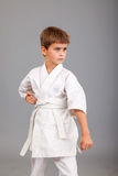 Karate boy in white kimono fighting Stock Images