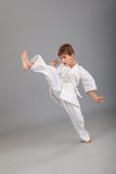 Karate boy in white kimono fighting Royalty Free Stock Photo
