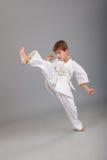 Karate boy in white kimono fighting Royalty Free Stock Photo
