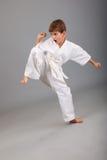 Karate boy in white kimono fighting Royalty Free Stock Image