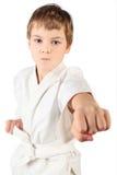 Karate boy in white kimono fighting isolated Royalty Free Stock Photo