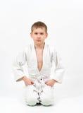 Karate boy in white kimono fighting Stock Images