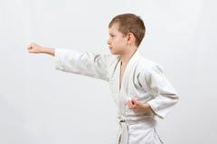 Karate boy in white kimono fighting Royalty Free Stock Photography