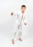 Karate boy in white kimono fighting Stock Photo