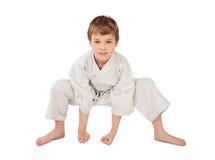 Karate boy in white kimono isolated Stock Photography