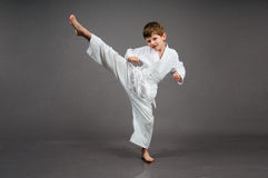 Karate boy in white kimono Stock Photography