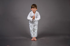 Karate boy in white kimono Stock Image